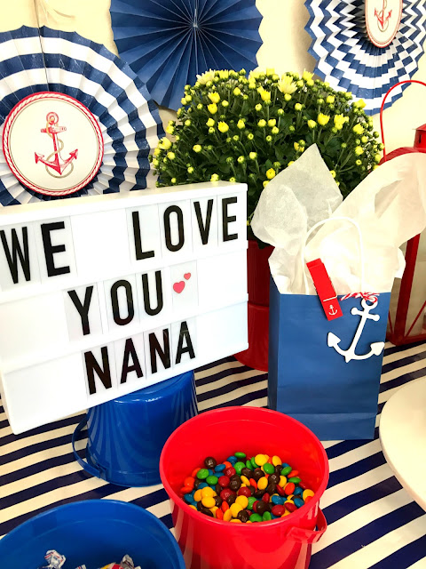 Table decorations for a nautical party.