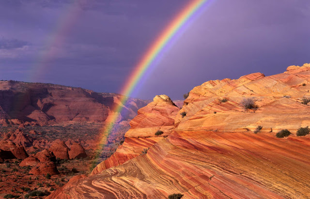 A rainbow over Coyote Buttes sandstone formations in northern Arizona.
