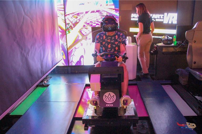 Renz Cheng playing Mario Kart VR in The Garage
