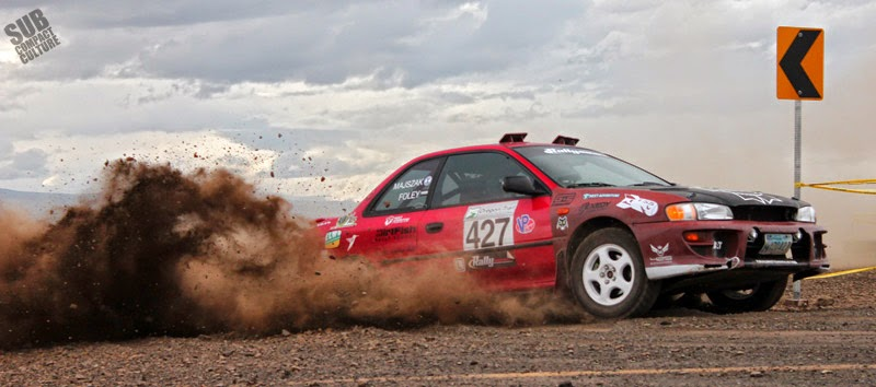 Subaru Impreza rally car throwing dirt