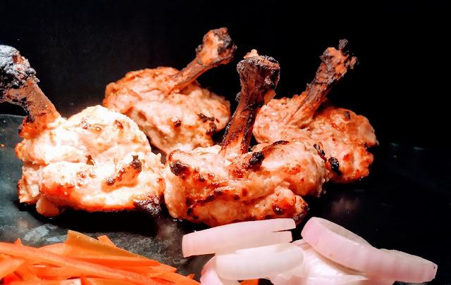 Chicken kalmi kebab with onions and garnish Food Recipe Dinner ideas