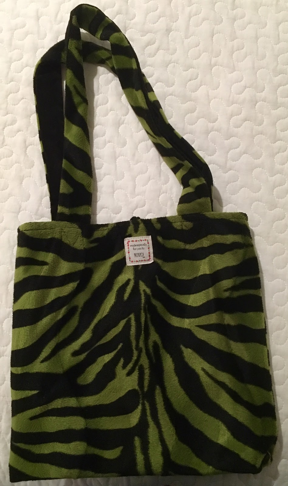 3b8ac77529a2 ... reversible Monica tote bag. Green + black stripe zebra-pattern plush  with reversible black velvet