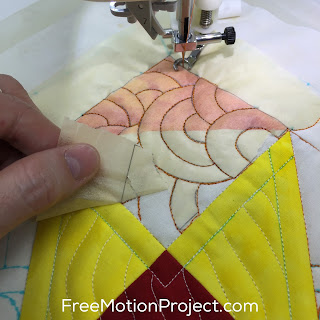 Learn how to mark a quilt block with paper in a tutorial with Leah Day