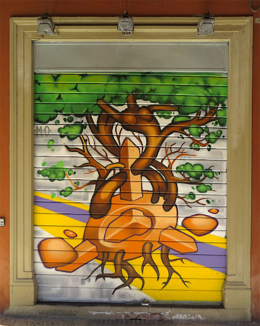 Rolling shutter painted with a mural, porticoes of Via Galliera, Bologna