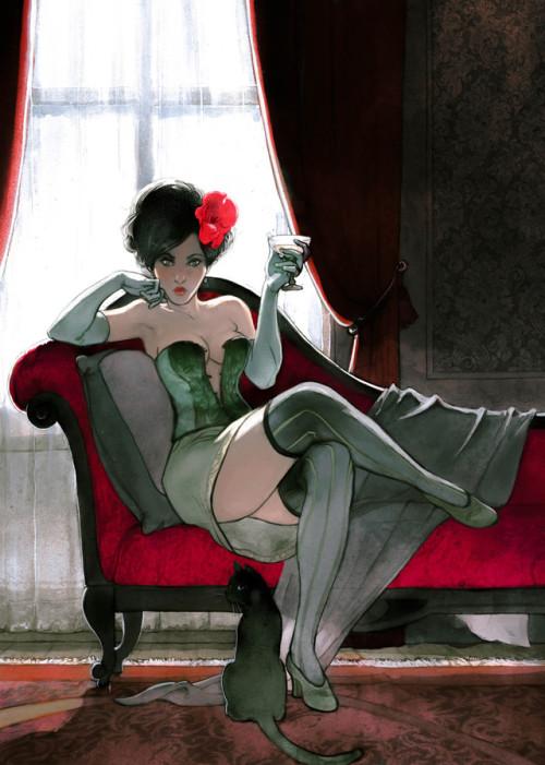 Mujer con medias negras sentada sobre un sillón rojo