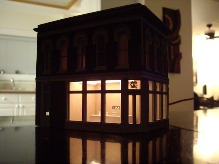 Completed DPM The Other Corner Café kit modeled as a bank showing interior lighting effects