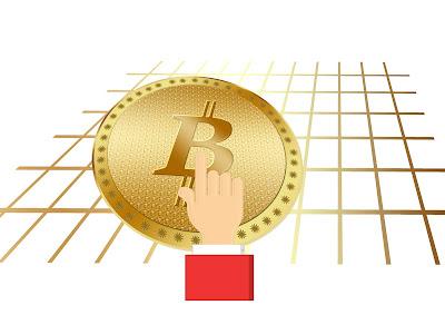 dedo sobre bitcoin