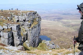 Cliff on mountain with walkers
