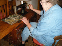 women using treadle sewing machine