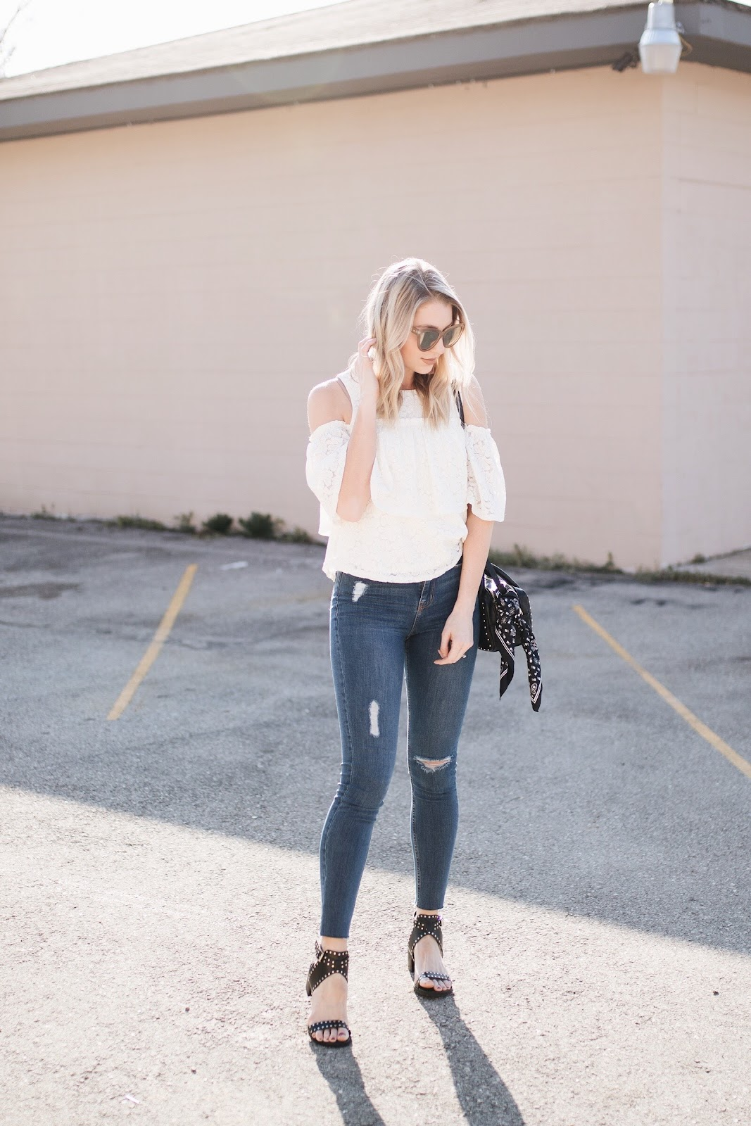 distressed skinny jeans (under $30) with a lace top for spring