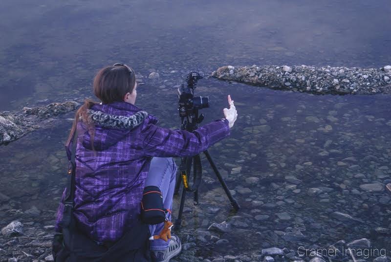 Landscape photographer Audrey Cramer setting up a landscape panorama photo at Henry's Lake Idaho