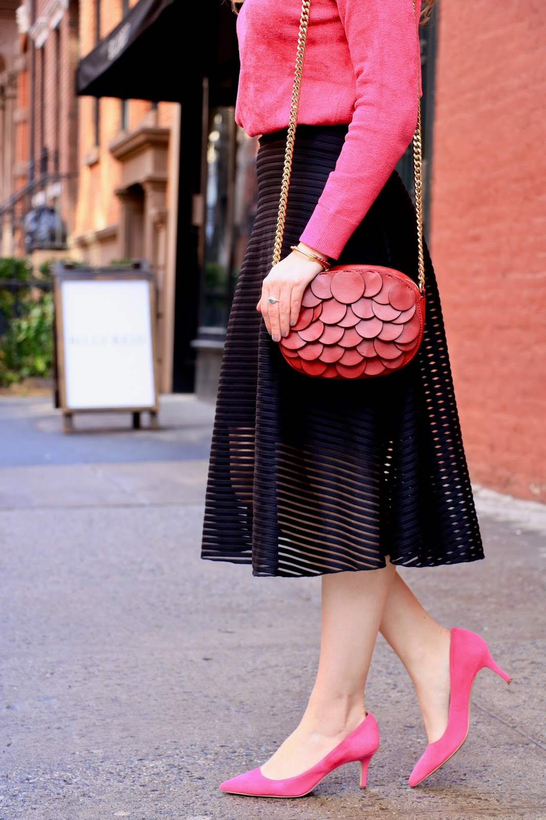 Nyc fashion blogger Kathleen Harper wearing a black midi skirt and pink heels