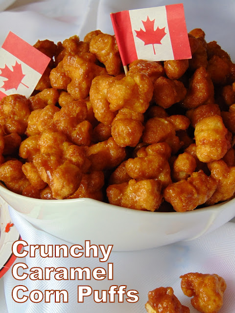 Crunchy Caramel Corn Puffs piled in a serving bowl with little Canadian Flags stuck in among the puffs.