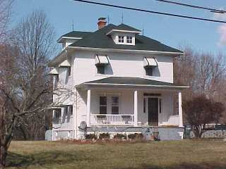 Photo of home after Roof Menders applied restoration green acrylic in 2004