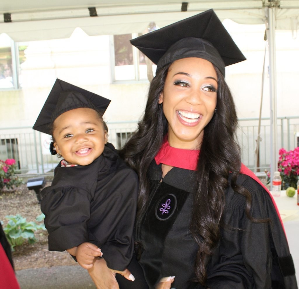 Briana Williams, 24, a single mother, was teary-eyed and beamed brightly as she carried Evelyn after receiving her Juris Doctor degree.