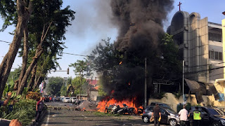 At least 11 dead in bomb attacks on Indonesian churches