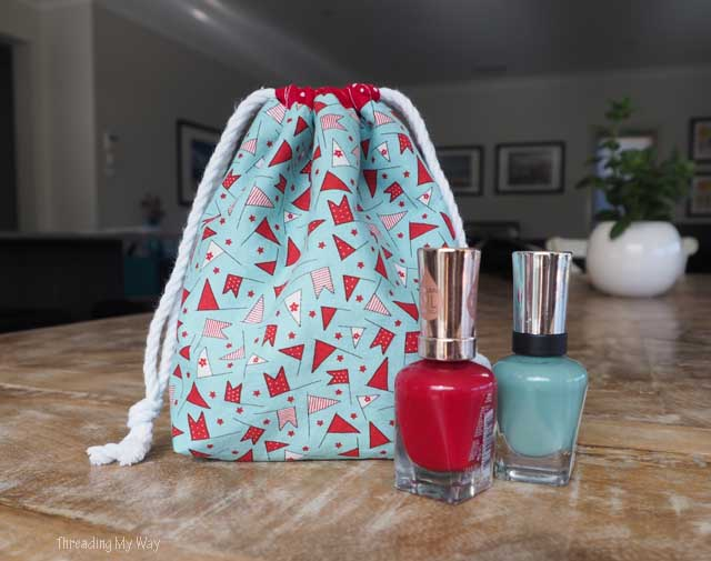 How to make a drawstring gift bag with a divider to hold nail polish. Tutorial by Threading My Way