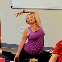 Yoga instructor demonstrates a pose