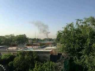 Smoke rises from the Presidential Palace in Kabul, 24 June 2013