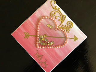 Hand made Valentine shaker card with pearls and die cut flourishes