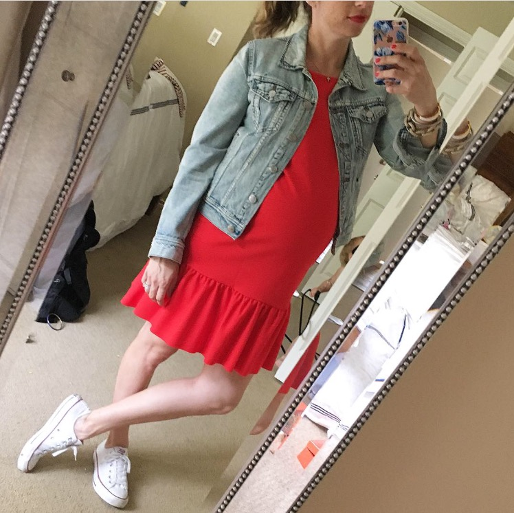 red maternity dress and jean jacket