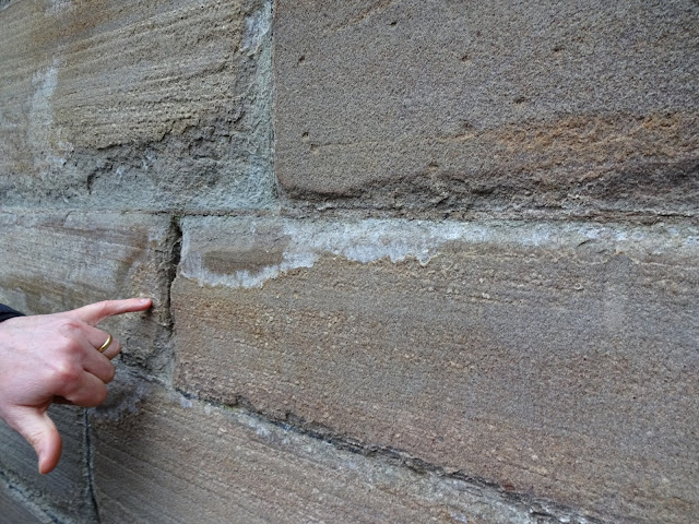 Decayed mortar joints, shown as disaggregation of the stone along the joints