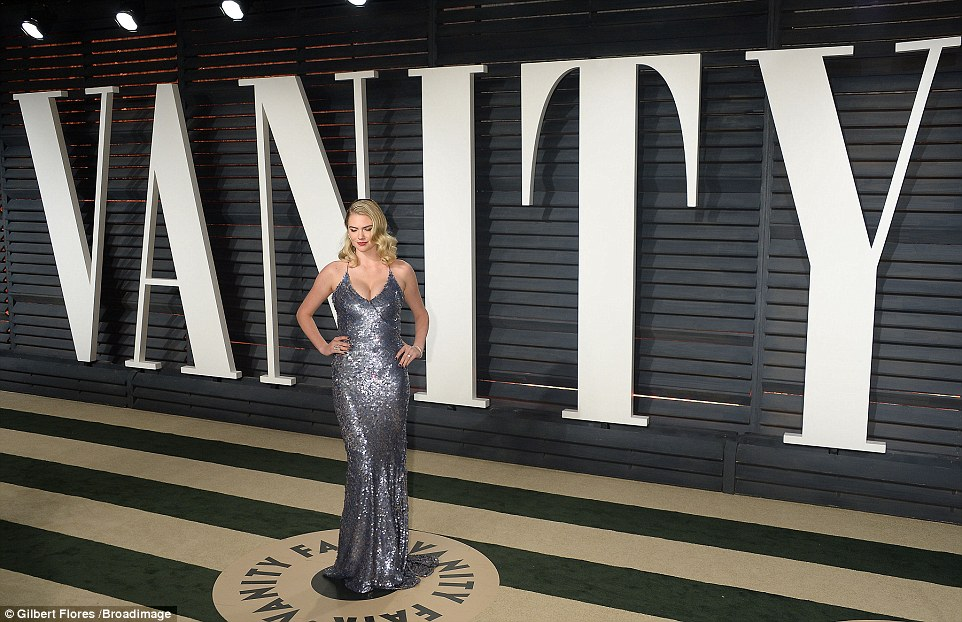 Kate Upton bares cleavage in a sequinned gown at the 2017 Vanity Fair Oscar Party