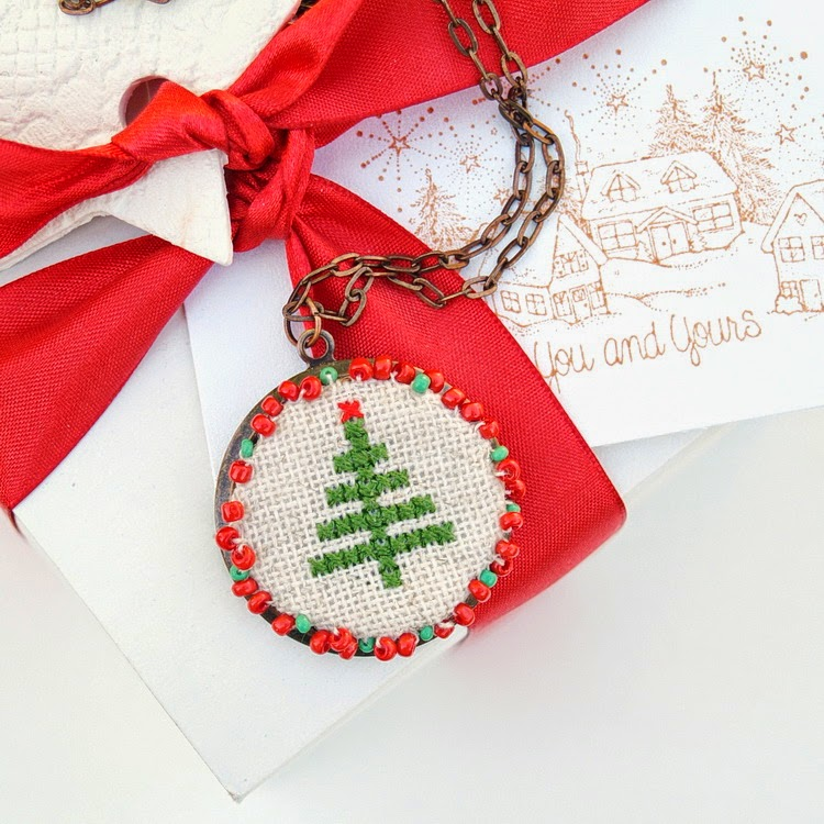 http://socksandmittens.blogspot.com/2014/12/a-holiday-tree-cross-stitch-necklace-diy.html
