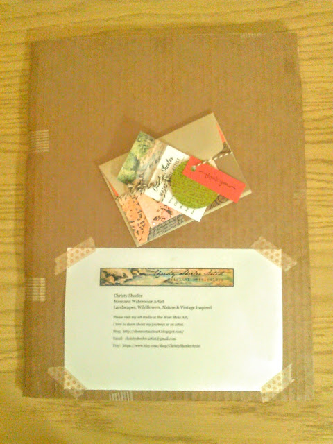 Packaging artwork for the buyer, cardboard folder taped securely, artist information attached with washi tape, and handmade note card by the artist.