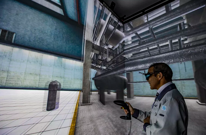An employee of the Naraha Center for Remote Control Technology Development presents a virtual representation of one of the Fukushima Daiichi reactors.  Our guide, an employee of the Naraha Center for Remote Control Technology Development, took us through a virtual representation of one of the reactors