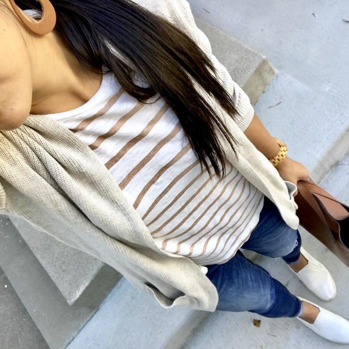 tan striped tee + beige cardigan + distressed jeans + white sneakers