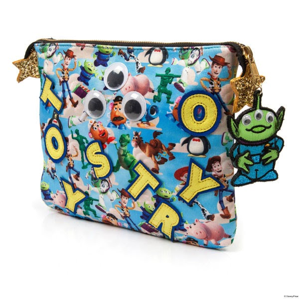 back of clutch bag shown at angle in Disney Toy Story printed material with yellow applique letters and alien zip pull