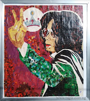 http://art.tugis.com.ng/2010/07/michael-jackson-collage-art.html