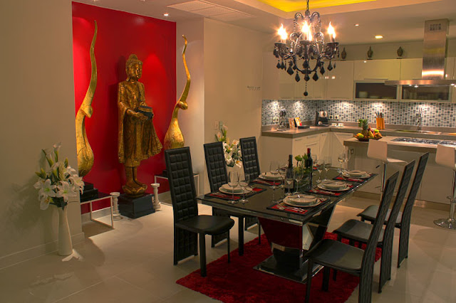 Picture of dining room with black furniture and Budha statue