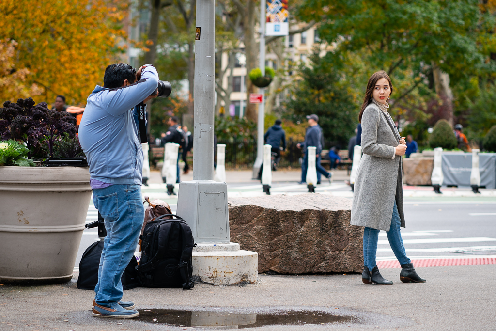 a photo of a photographer working with a model on the street in chelsea new york city candid