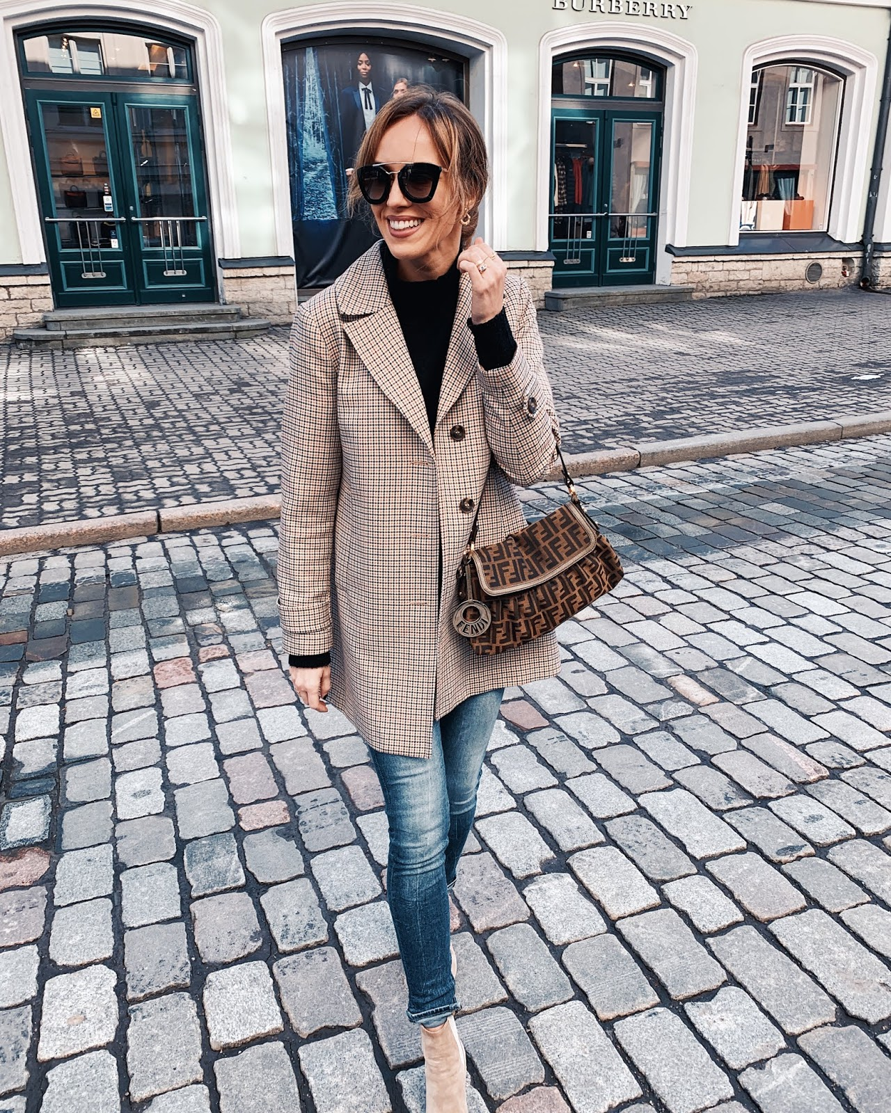 checked coat jeans suede chelsea boots spring outfit