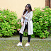 linen trenchcoat, sporty APC pullover and new Nike sneaker