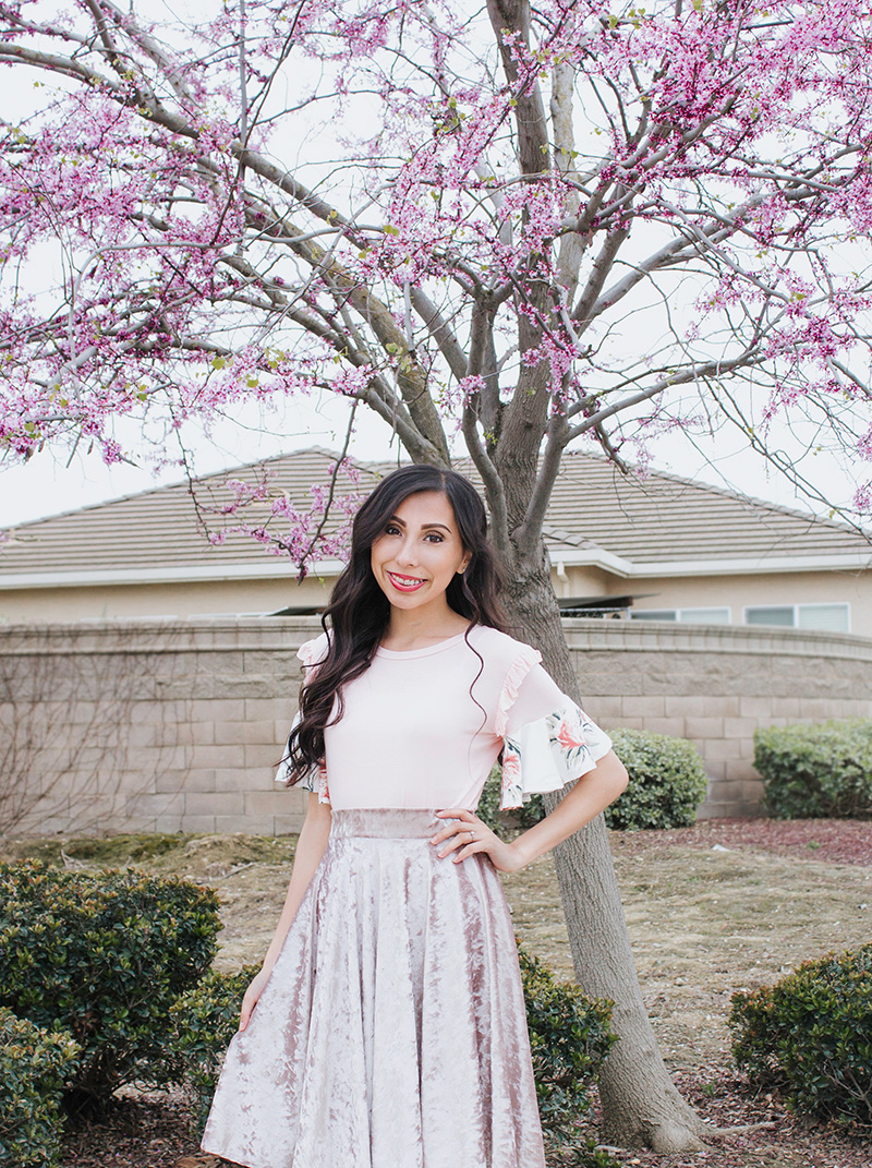 blush top with floral flounces and velvet circle skirt