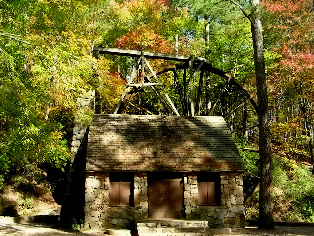 On the grounds of Berry College in Georgia, a small stone cabin is the home of an old wooden water wheel.