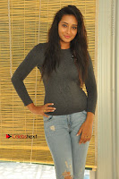 Actress Bhanu Tripathri Pos in Ripped Jeans at Iddari Madhya 18 Movie Pressmeet  0021.JPG