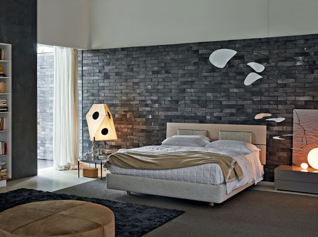 A wall of grey exposed brick leads to the rest of the interior
