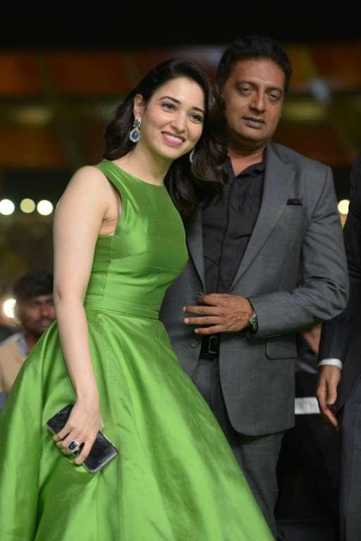 Tamannaah Bhatia and Prakash Raj pose for photographers during IIFA Utsavam