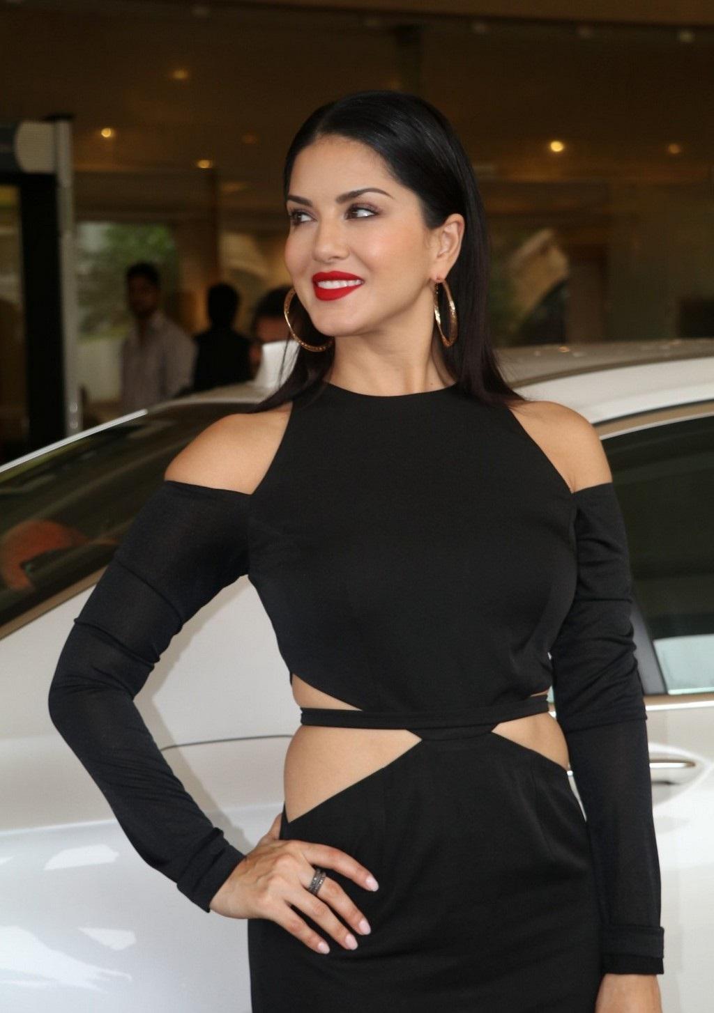 Bollywood Actress Sunny Leone Hot Legs Show Stills In Black Dress