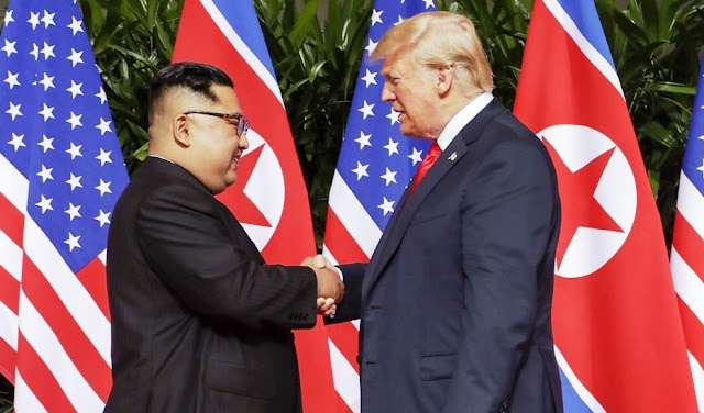 US President Donald Trump Shakes Hands with North Korean Leader Kim Jong-un