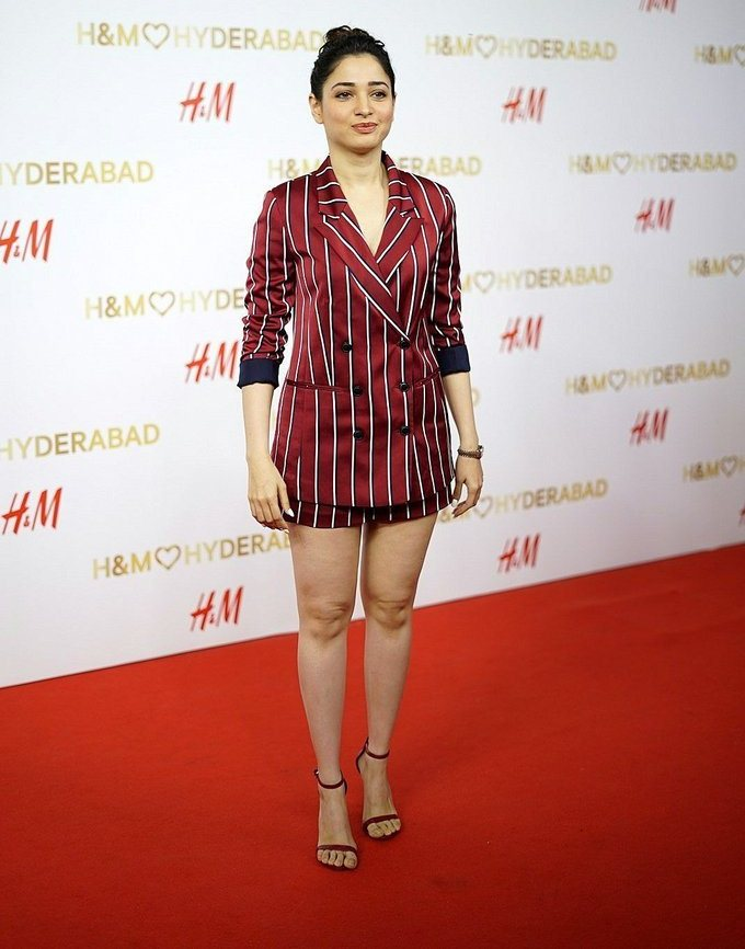 Tamanna White Legs Thighs Show At Red Carpet In Mini Maroon Top