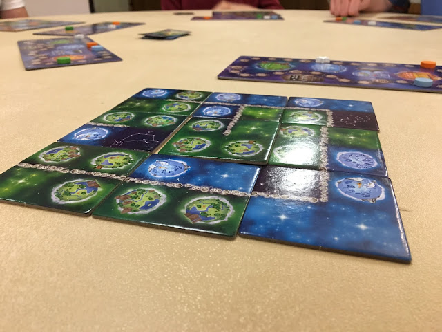 Real-time board game Kaosmos or Cosmic Factory by Kane Klenko at Gigamic Games 3x3 grid galaxy