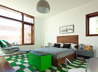 Habitación decorada en gris y verde