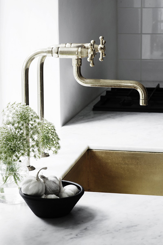 Brass sink and marble countertop via KBH