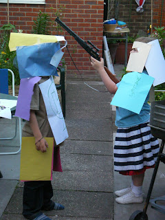homemade lego hero costumes made of paper and sellotape
