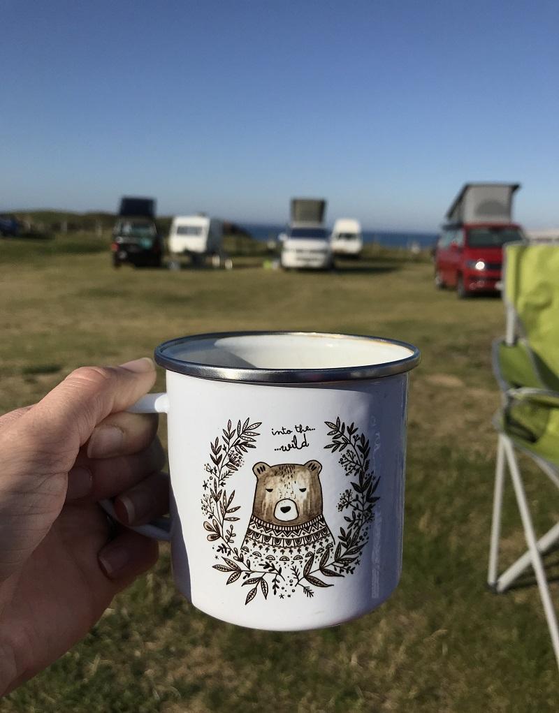 """Into the wild"" Juniper Press mug at Clachtoll campsite"